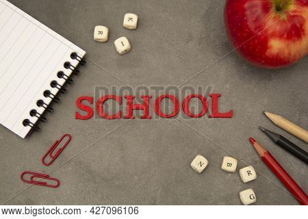 Word School With Office Supplies. Education Concept, Black Board. Top View.