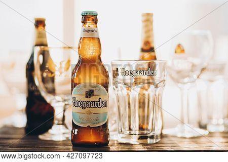 Lviv, Ukraine - December 1, 2017: Hoegaarden Beer Bottle And Glass In Warm Sunny Light On Background