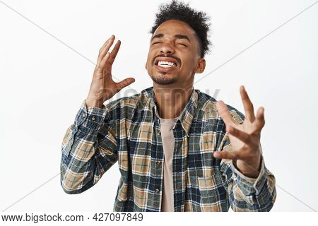 Image Of Happy And Relieved African American Man Rejoicing, Feeling Pleasure And Delighted, Smiling