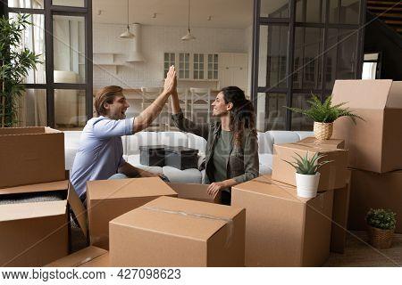 Joyful Family Couple Apartment Renters Buyers Celebrate Starting Independent Life