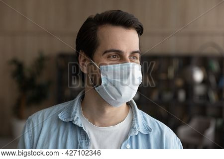 Dreamy Young Businessman Wearing Facial Protective Mask.