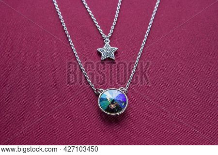 Silver Lapis Lazuli Stone Necklace Pendant With Leaves Decoration Isolated On White Background. Silv