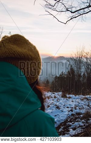 Beautiful Young Lady Aged 20-25 Looking At A Beautiful Winter Sunset In The Mountains In The Czech R