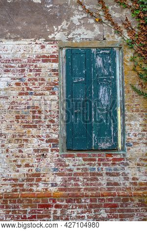Antique Brick And Old Shutters On This Abandoned Winerey In New Egypt New Jersey.