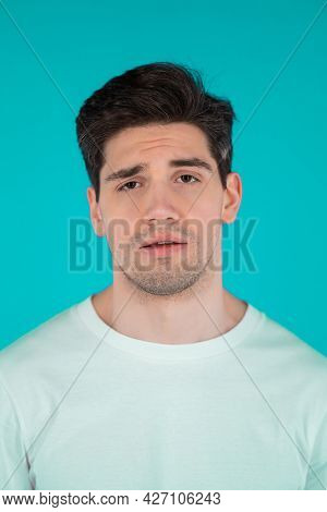 Frustrated European Man Over Teal Wall Background. Guy Is Tired, Bored Of Work Or Studying, He Disap
