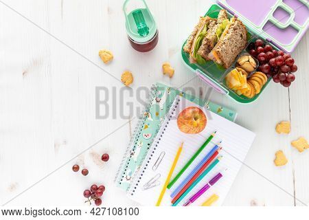 Top Down View Of School Supplies And Lunch On A Light Background. Back To School Concept.