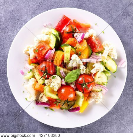 vegetable salad with carrot, cauliflower,  tomato and zucchini