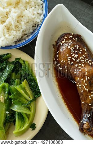 Top View Fast Food Of Chicken Leg With Vegetable And Rice Vertical Composition