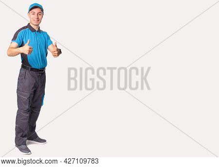 Delivery Concept - Portrait Of Happy Delivery Man Standing And Showing Thumbs Up For Successful Parc