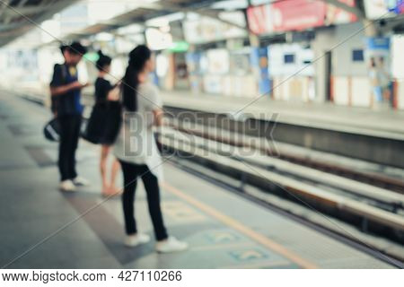 Blur Image Of People Standing For Waiting For Traveling To Work Using The Bts (bangkok Transit Syste