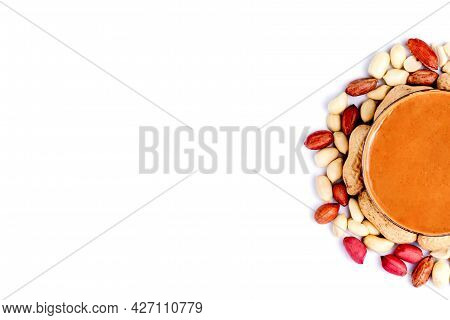 Peanut Butter Isolated And Peanuts In The Peel Scattered On The White Background. Copy Space.