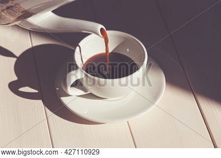 Pouring Coffee Into Coffee Cup - Summer Morning With Bright Sunlight And Shadows, Coffee Pot, White