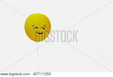 Funny Emotion Face Symbol On Yellow Balloon