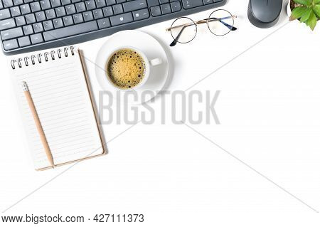 White Office Desk Table, Blank Notebook With Laptop And Black Coffee. Top View With Copy Space, Flat