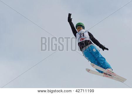 BUKOVEL, UKRAINE - FEBRUARY 23: Zhanbota Aldabergenova, Kazakhstan performs aerial skiing during Freestyle Ski World Cup in Bukovel, Ukraine on February 23, 2013.