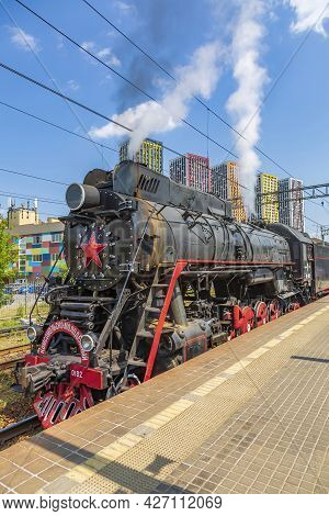 Black Retro Steam Locomotive At The Railway Station On A Sunny Day