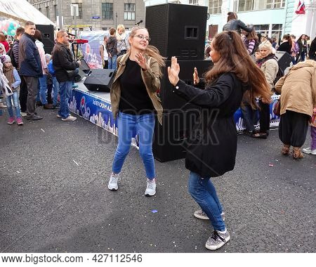 Moscow, Russia, September 10, 2016:t Wo Pretty Women Dancing In The Street. Happy People Have Fun On