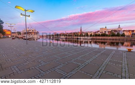 Szczecin. City Embankment In The Historical Part Of The City At Dawn.