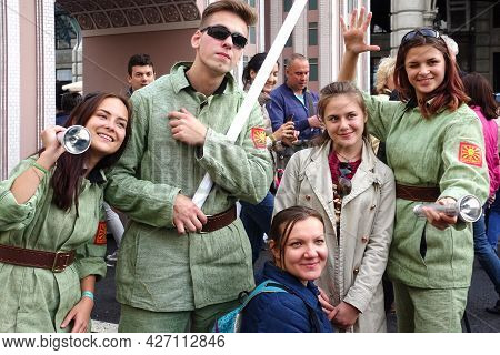 Moscow, Russia, September 10, 2016: A Group Of Cheerful Cute Young People In Bright Costumes Pose Fo