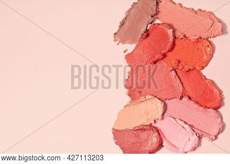 Various Lipstick Smudged. Mat Lipstick Texture Background