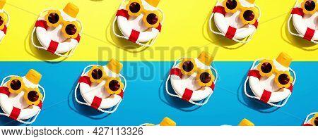 Sunblock Bottles Wearing Sunglasses And Buoys - Flat Lay