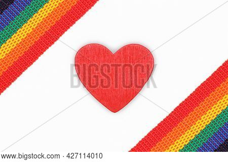 The Rainbow Belt Or Ribbon Is A Symbol Of Lgbtq, In The Middle Is A Heart On A White Background.the