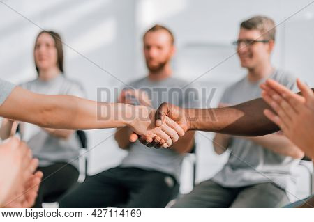 Close Up. Strong Handshake Of Partners During The International