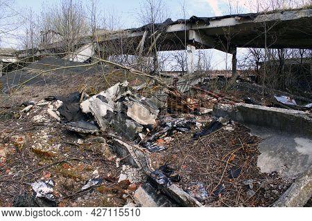 Destroyed Abandoned Hangar Building Ruins. Farm Hangar Destroyed By Weather After Economic Crisis.