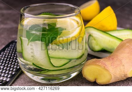 Fresh Cold Water With Lemon, Cucumber, Ginger, Mint And Ice In A Glass Close-up. Sashi Slimming Wate