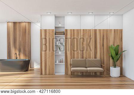 Bathroom For Hotel Interior. Dark Beige Bathtub, White Walls, Shelves And Ceilings. Beige Armchair W