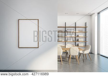 Empty White Poster On The Partition Wall Of The Hotel Loft Interior With Shelving Unit And Table Wit
