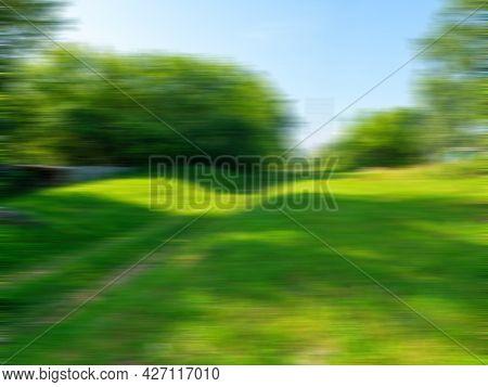 Abstract Blurry Summer Landscape. Green Grass. Blur