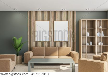 Two Banners On The Wooden Detail Of Green Wall In The Living Room With Sand Beige Furniture. Interio