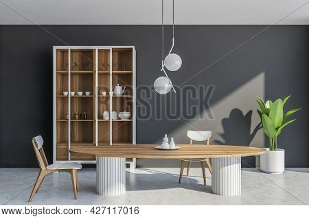 Interior With Oval Dining Table With Wooden Top, Two Chairs, Cupboard With Crockery And Sliding Glas