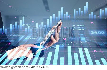 Businesswoman With Tablet In Hands Is Touching The Screen In Order To Trade Successfully. Concept Of