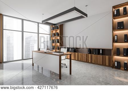 Luxury Office Interior With Classy Rectangular Chandelier, Wooden Shelving Unit With Black Folders,