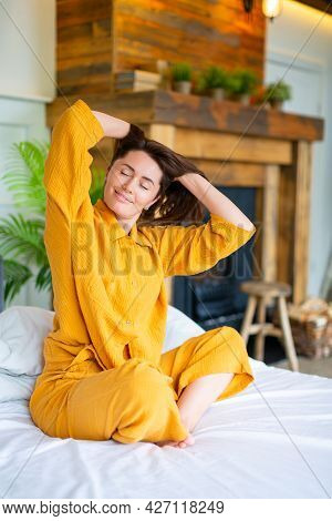 Photo Of A Beutiful Woman Woke Up And Stretching. She Stretched Her Arms And Enjoys The Day Off.