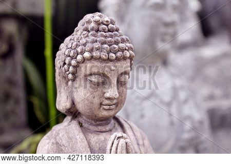 Buddha Stone Statue Close Up. Traditional Buddhist Sculpture For Home Or Temple Decoration