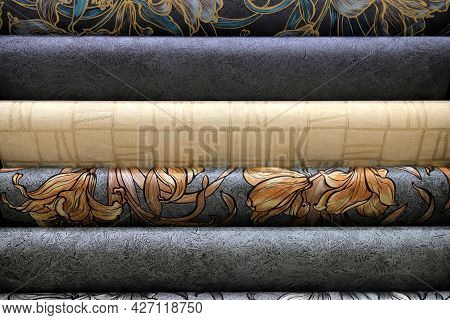 Rolls Of Vinyl Wallpaper. Various Textures And Colors Of Paper For Wall. Decorative Finishing Materi