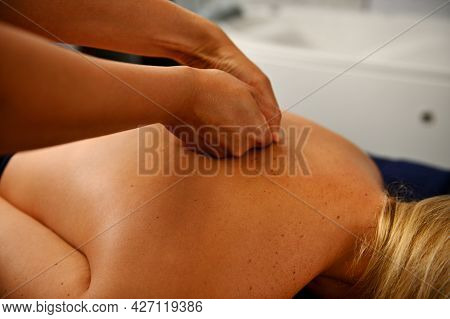 Back Massage In The Spa Salon. Muscle Recovery After Exercise. The Masseur Doing A Back Massage. Spo