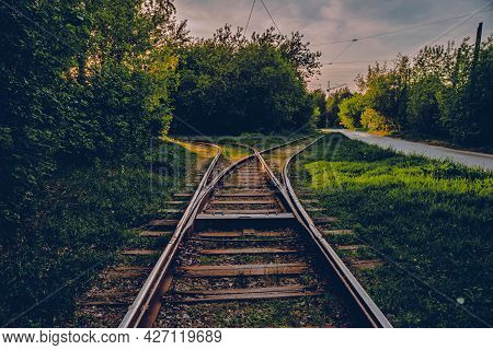 A Fork In The Railroad Tracks In Two Directions. A Close-up View Of A Railroad Track.