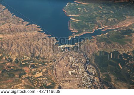 Big Dam Is A Concrete Arch-gravity Dam On The River In Kazakhstan. View Of The Dam From The Airplane