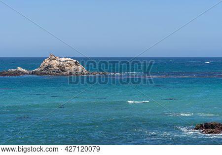 San Simeon, Ca, Usa - June 8, 2021: Pacific Ocean Coastline North Of Town. Piedras Blancas Small Whi