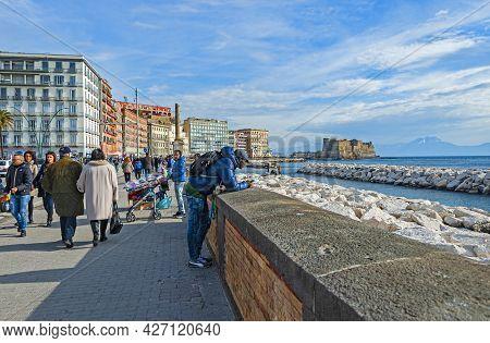 Naples, Italy - January 21, 2017: People Strolling The Lungomare Caracciolo,  Romantic Seaside Prome