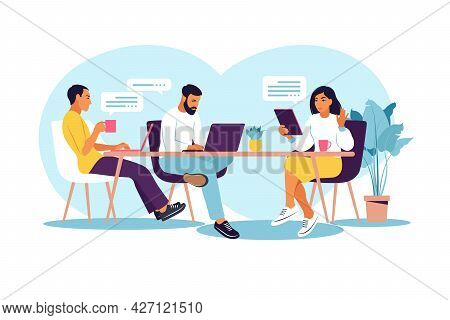 Business People Working Together. Coworking Space With Creative Or Business People Sitting At The Ta