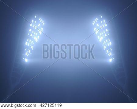Stadium Floodlights Against Dark Foggy Night Sky With Copy Space