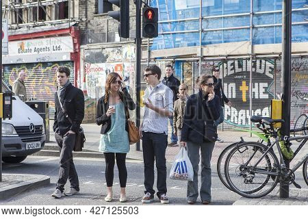 London, Uk - September 2019, People At The Pedestrian Crossing Are Waiting For The Traffic Light To