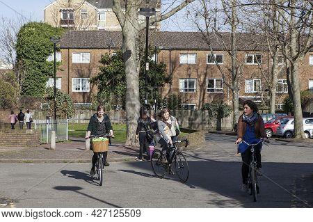 London, Uk - November 2019, Three Girls On Bicycles Ride Off Columbia Road Flower Market