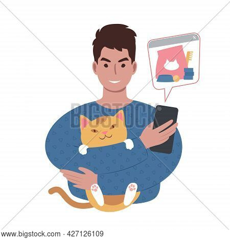 Young Caucasian Man With A Cute Cat Ordering Pet Supplies Online From Smartphone.