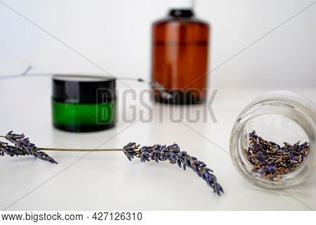 Essential Lavender Oil And Dry Lavender Flowers.